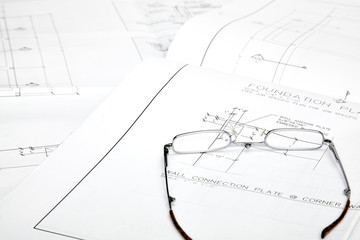 Blueprints with reading glasses