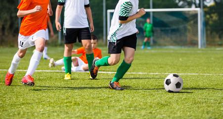 Football match for children. Boys playing football match