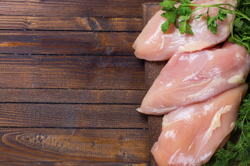 Raw  chicken meat  on wooden table