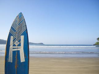 Blue surfing board with blue sky in Sri Lanka