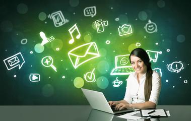 Businesswoman with social media symbols