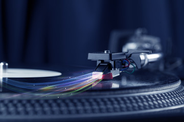 Music player playing vinyl music with colourful abstract lines