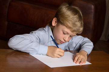 Boy drawing on paper
