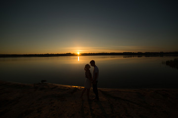 Couple and sunrise