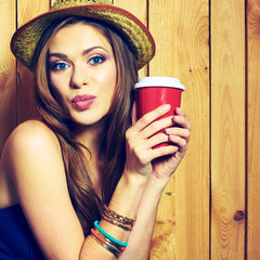 Kissing Hipster Girl Holding Coffee Cup.