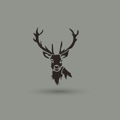 Artistic vector silhouette of a deer. Creative idea logotype.