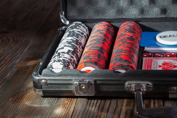 Suitcase with poker cards and chips
