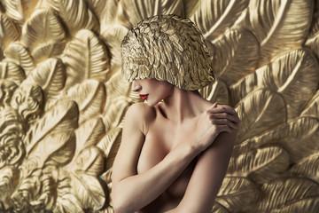 Conceptual portrait of a seductive lady wearing feather hat