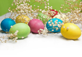 Easter eggs on a white tablecloth