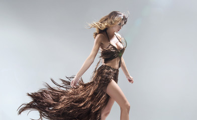 Conceptual portriat of the woman wearing dress made of hair
