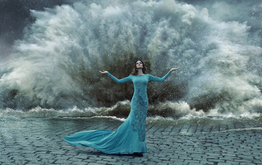 Alluring, elegant woman over the sand&water storm