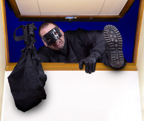 A robber enters the house through the roof window