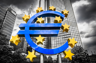 Euro sign with dark dramatic clouds symbolizing financial crisis