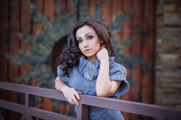 Beautiful girl on a background of wooden gates