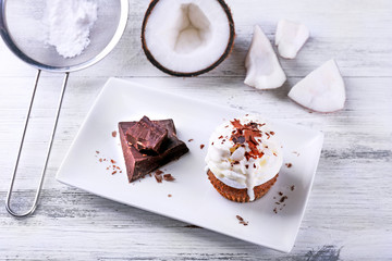 Delicious coconut cupcake with cream and chocolate chips