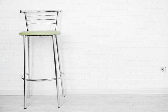Bar high chair on white brick wall background