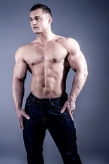 Muscular young man in jeans.