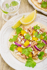 Tacos for lunch with chicken, pineapple salsa, purple onion and