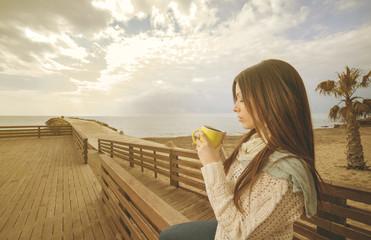 girl drinking a tea in a mug warm filter applied