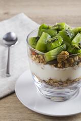 Granola, yoghurt and kiwi