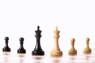 Mixed black and white chess pieces