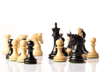 black and white chess pieces isolated on white background