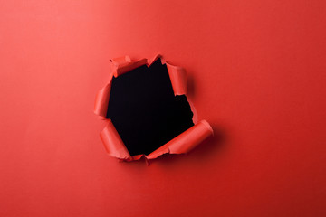 Red paper with hole.