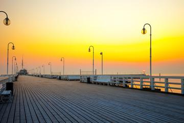 Fotobehang Meloen Sunrise at the pier in Sopot, Poland.