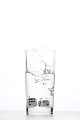dice in a glass of water