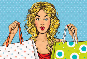 Pop Art blond women with shopping bags in the hands