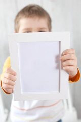 picture frame in hands of a child