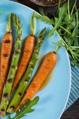 colorful spring healthy dish with grilled carrots and asparagus
