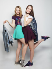 Two young girl friends having fun together.