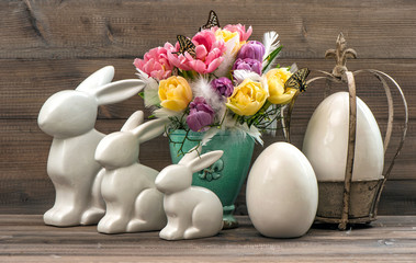 Easter decoration with tulip flowers, eggs and bunny