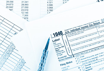 Tax form 1040  for US individual tax return with pen