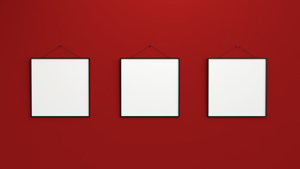 Composition of three black blank photo frames on red wall 3d ren
