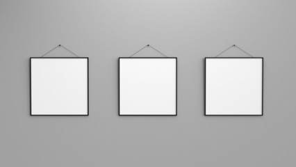Composition of three black blank photo frames on grey wall 3d r
