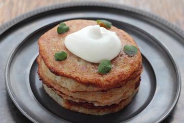 Potato pancakes with sour creme and oregano.