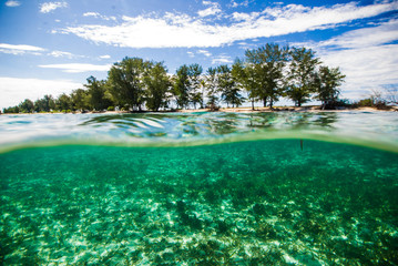 crystal clear water kapoposang indonesia scuba diver