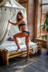 Beautiful woman posing in apartment