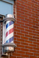 Barber Pole and Brick Wall