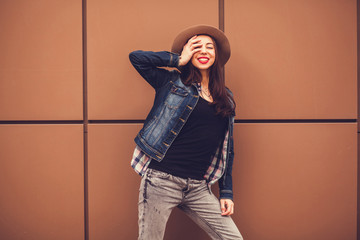 beautiful model smiling in a hat with long hair