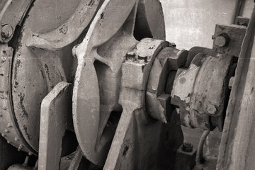 Closeup fragment of bow anchor winch on old ship