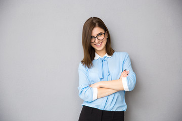 Portrait of a happy businesswoman with arms folded