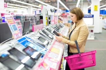 Woman buys a digital tablet