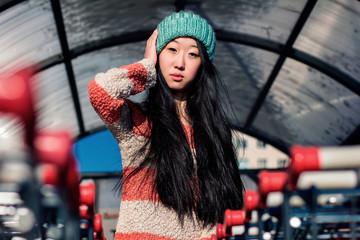 portrait of stylish Asian girls near small cart
