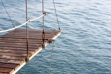 Wooden diving board above the sea. Selective focus.