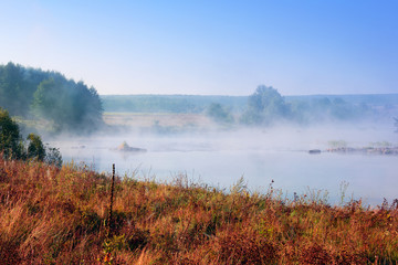 landscape of the valley, the river with dense fog, the trees, an