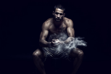 Muscular handsome man in Studio with flour