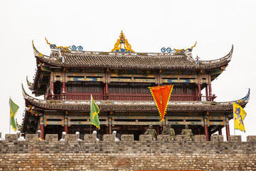 Colorful Chinese Temple with Clay Soldiers and Battlement